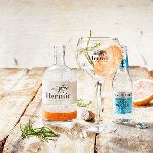 https://hermitgin.com/wp-content/uploads/2019/10/Hermit-Gin-Brand-image-Wood-Glass-FT-med-2560x1707.jpg